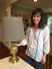 "This heavy, all brass pineapple lamp is a favorite. Megan Church describes her style as ""cozy modern."""