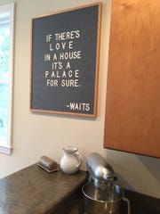 """A Tom Waits quote holds pride of place near a KitchenAid mixer, which Megan says the family uses """"almost every day."""""""