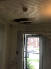 The hole in the ceiling has been repaired by replacing the beadboard, owner Gary Lane said. City inspection reports verify that the problem has been corrected.