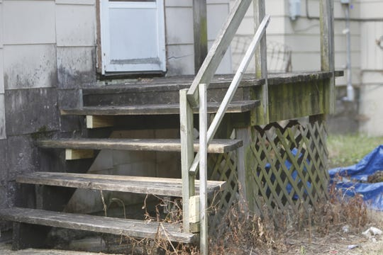 These steps, which were cited in the city's inspection of 400 N. Salisbury St., have new braces to support the stairs. But the wood has not been replaced.