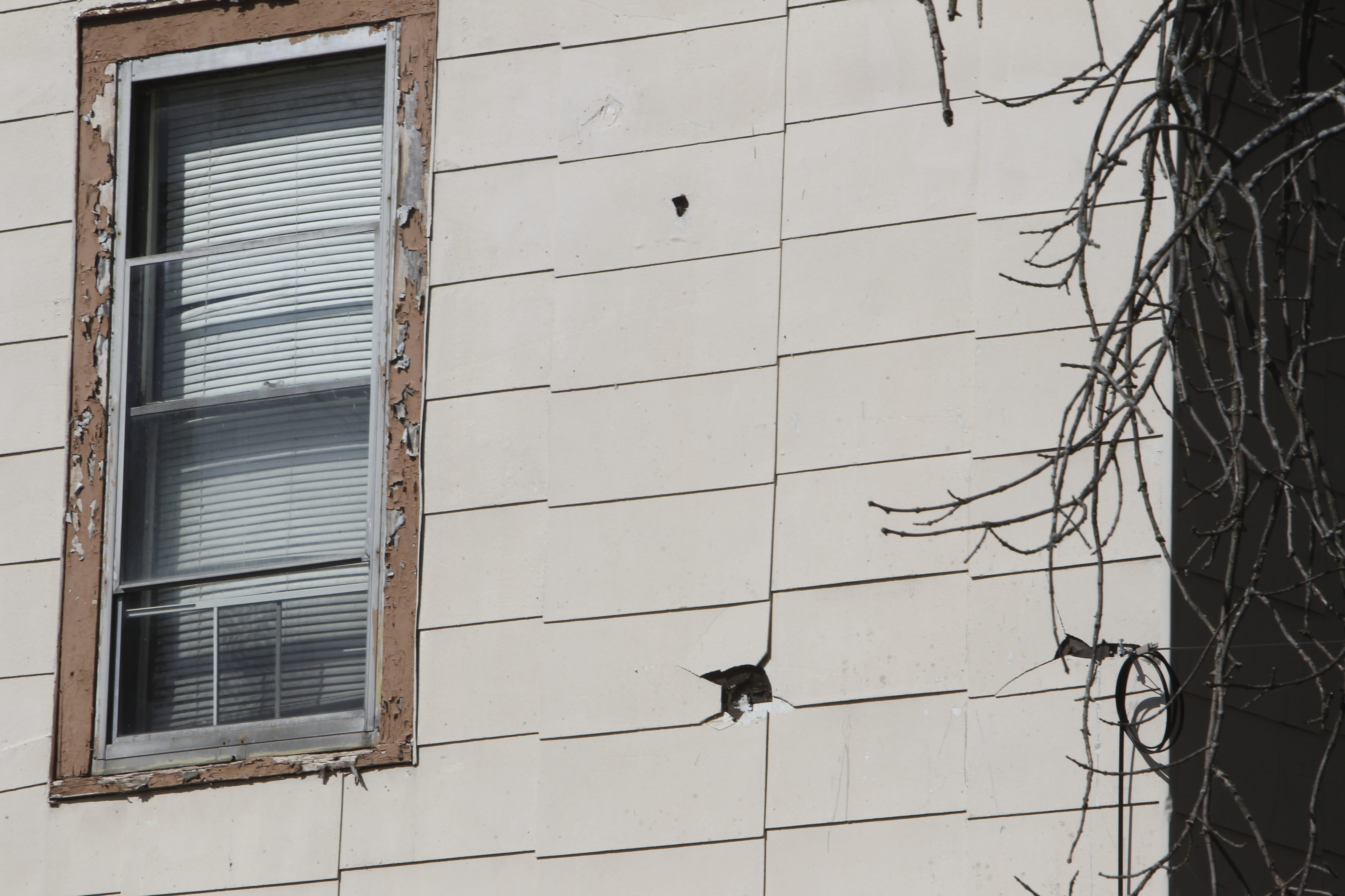Holes in the exterior tiles and peeling paint around windows are two deficiencies noted on the city's inspection report for 400 N. Salisbury St. Owner Gary Lane said he intends to repair the exterior and paint it.