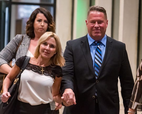 Lafayette City Marshal Brian Pope (R) and his wife Karrie leaving court after jury returned guilty verdict Wednesday evening on one count of perjury and three counts of malfeasance in office. . Wednesday, Oct. 3, 2018.