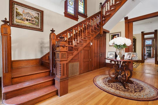 The home features original woodwork and elaborate stained glass.