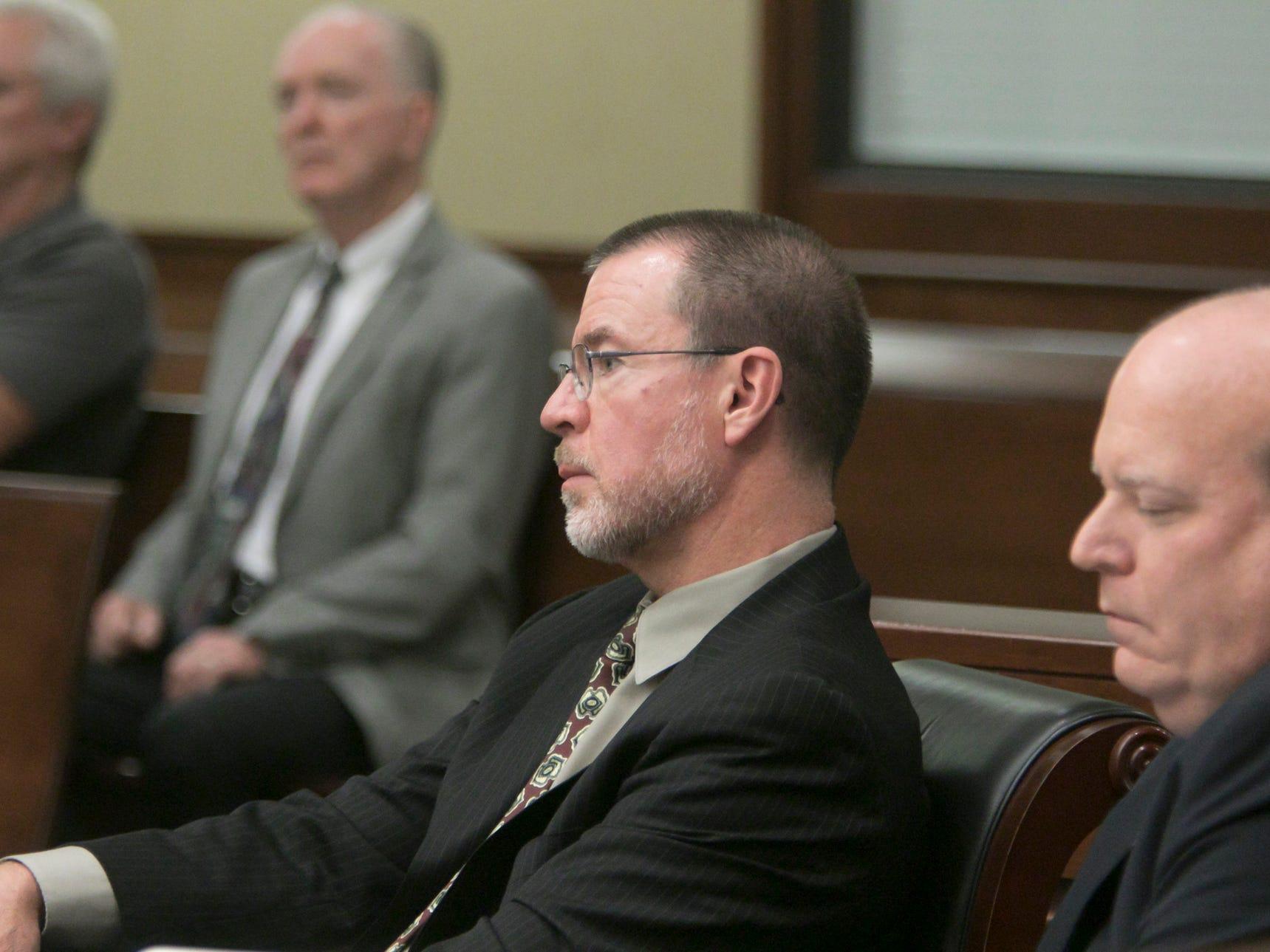 JTC executive director Lynn Helland and associate examiner Casimir Swastek listen to testimony from attorney Amy Krieg Thursday, Oct. 4, 2018.