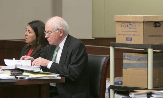 Judge Theresa Brennan and her attorney Dennis Kolenda listen to testimony at the Judicial Tenure Commission hearing Thursday, Oct. 4, 2018, seated next to boxes of documents.