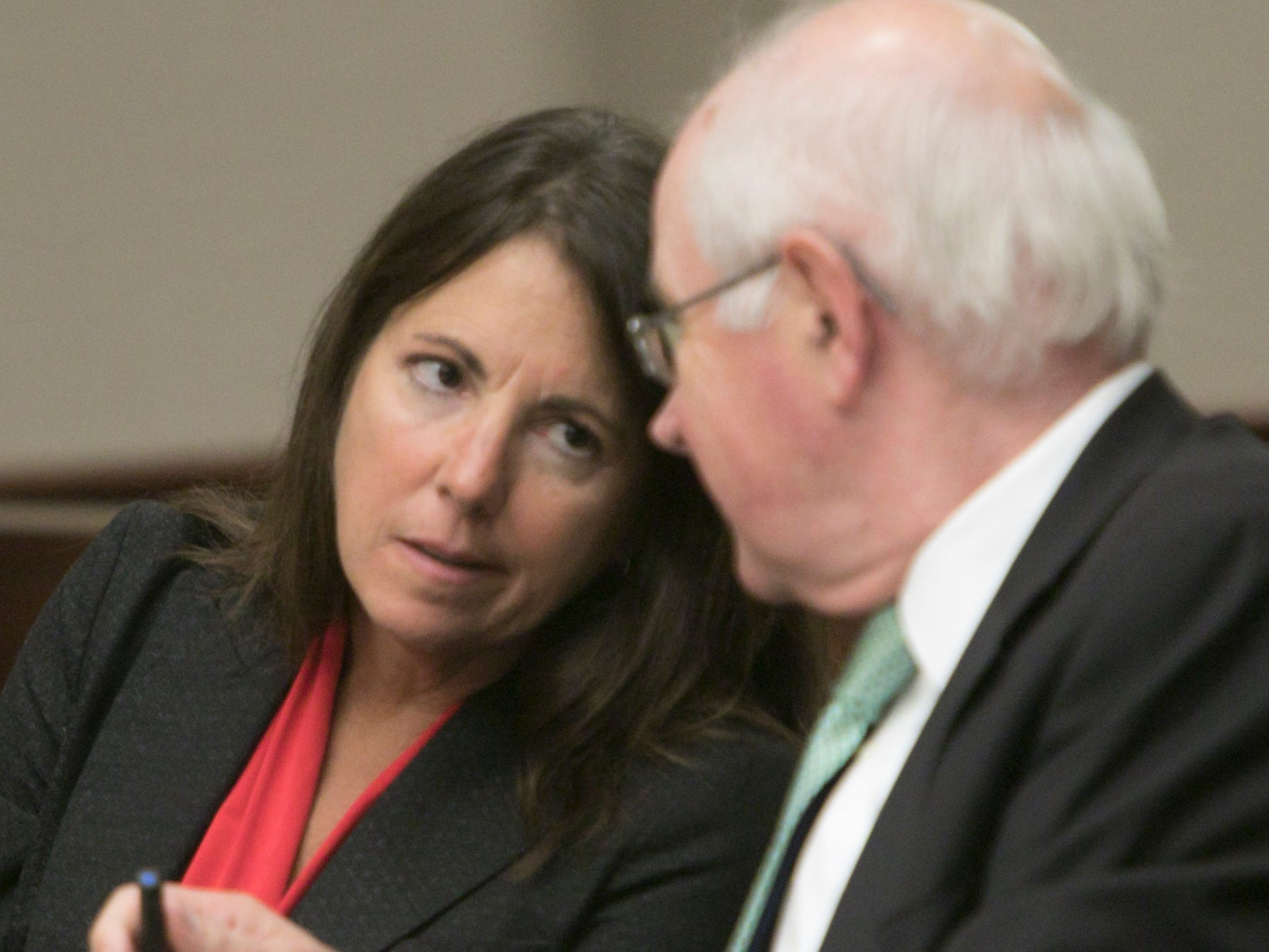 Judge Theresa Brennan speaks with her attorney Dennis Kolenda Thursday, Oct. 4, 2018 in a Judicial Tenure Commission hearing in Livonia.
