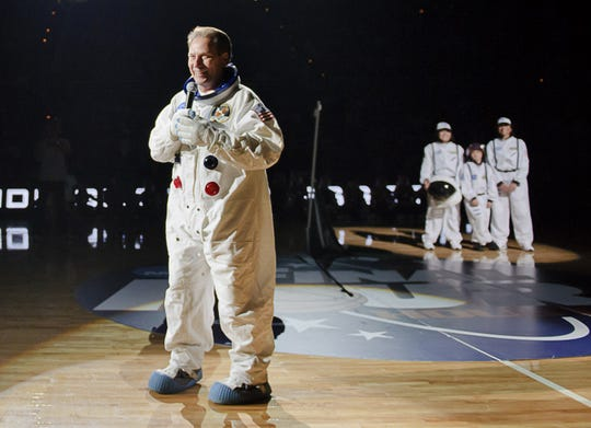 MSU Men's Basketball head Coach Tom Izzo (center) speaks to the crowd while wearing a space suit during Midnight Madness Friday October 15, 2010 in East Lansing.  The event had an outerspace theme as the Final four this season will be held in Houston, the home of NASA.