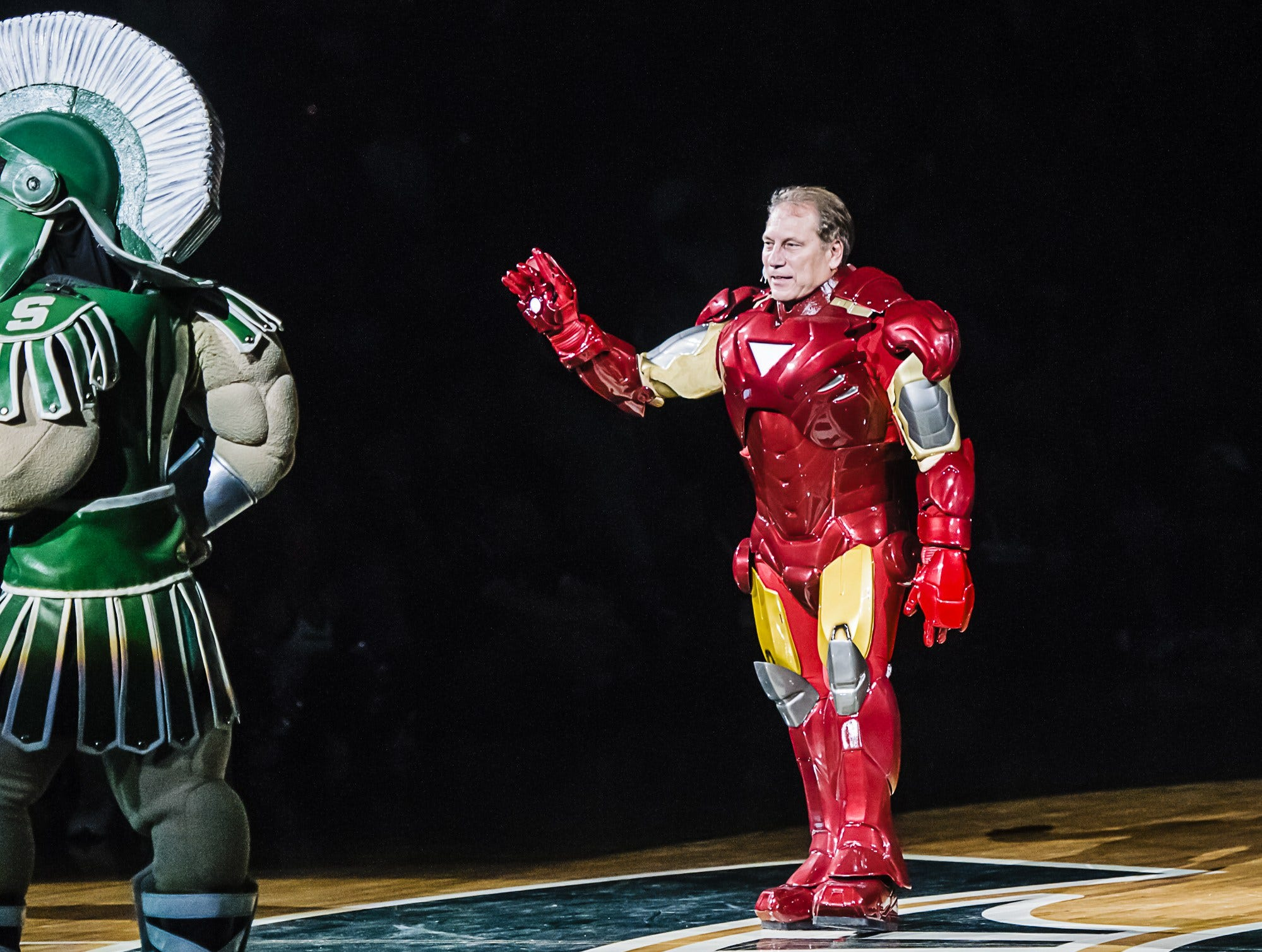 MSU Men's Basketball Head Coach Tom Izzo (right) costumed as Iron Mountain Man greets the crowd during Michigan State Madness Friday October 12, 2012 in East Lansing.