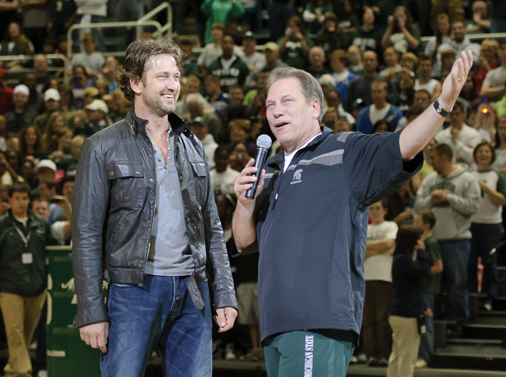 """MSU coach Tom Izzo (right) introduces actor and star of the film """"300"""" Gerard Butler to the crowd during Midnight Madness Friday October 15, 2010 in East Lansing."""