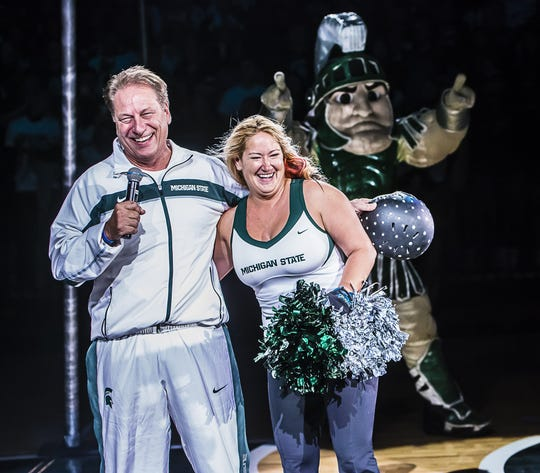 MSU Men's Basketball Head Coach Tom Izzo (left) shares a laugh with Jennifer Smith-Schneider who actually was shot out of a cannon during Michigan State Madness Friday October 18, 2013 at the Breslin Center in East Lansing.