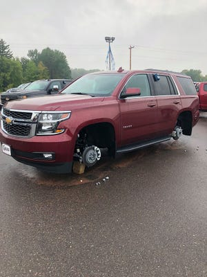 Tires were taken off of a Chevy Tahoe on Wednesday morning at Gross Motors in Neillsville.