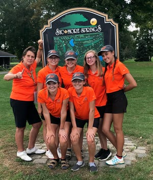 Nancy Noble and her Ashland girls celebrate their repeat title in the Division I girls sectional golf tournament.