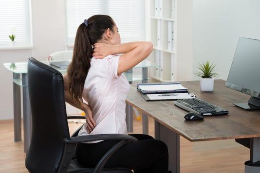 Businesswoman Having Backpain In Office