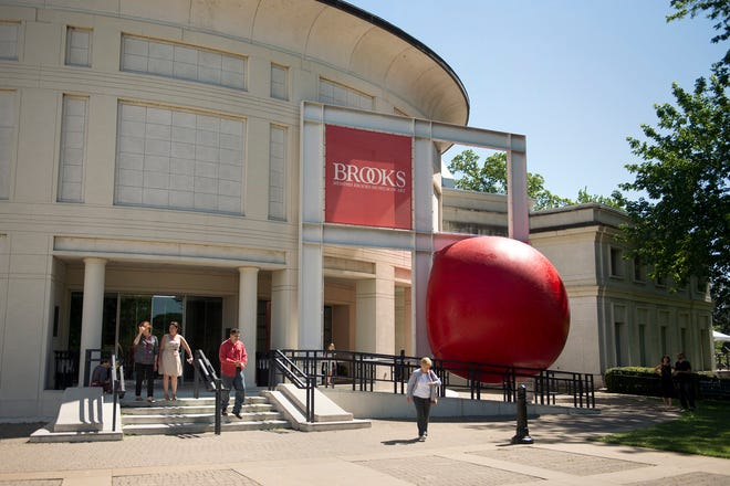 A giant inflatable ball made for the RedBall Project by aritst Kurt Perschke sits wedged in front of the Memphis Brooks Museum of Art on April 28, 2016.