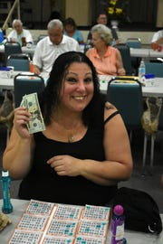 Lisa Piacenza of Naples celebrates a winning card. Bingo has returned to the Jewish Congregation of Marco Island, every Monday evening.