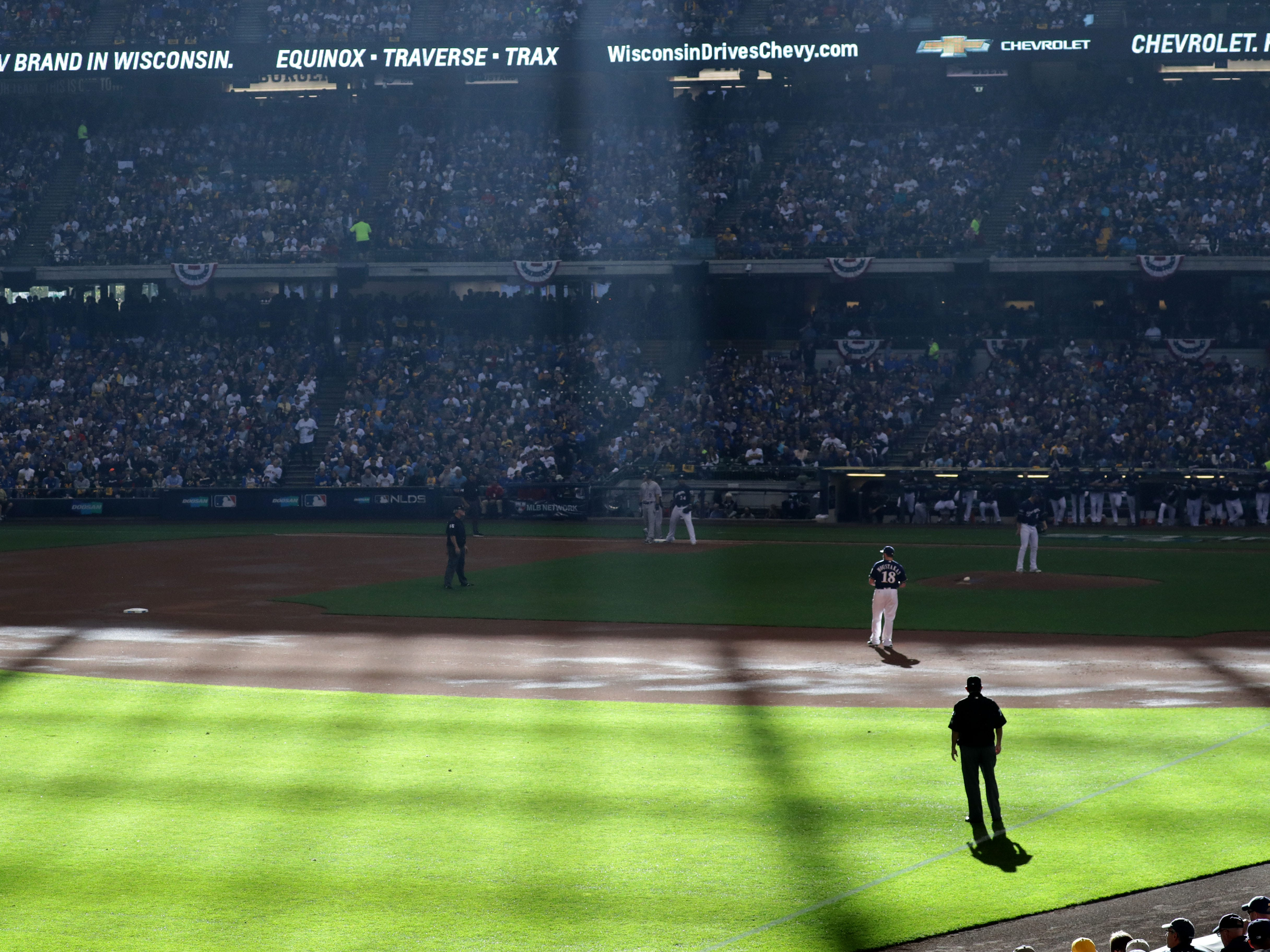 Sunlight shines on the field during the Milwaukee Brewers' National League Divisional Series game against the Colorado Rockies on Thursday.