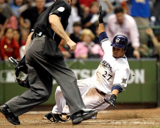 Carlos Gomez scores the winning run. in Game 5 of the NLDS in 2008.