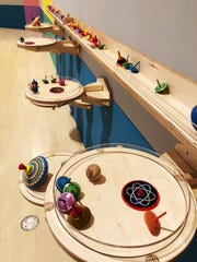 "There are interactive things to do at the ""Serious Play"" exhibition at the Milwaukee Art Museum, including tops to play with."