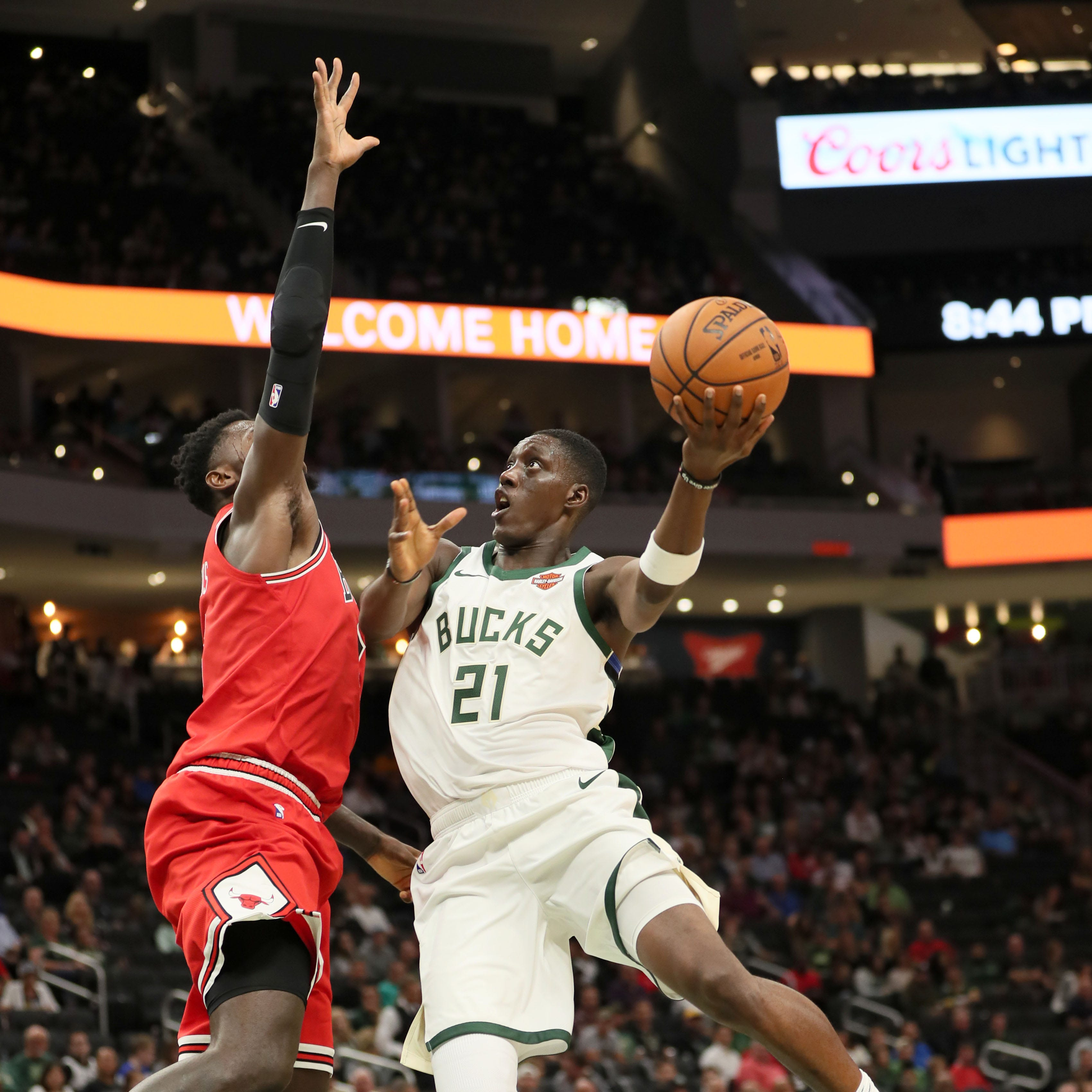 The Bucks' Tony Snell goes up for a shot against at Bulls defender on Monday night at Fiserv Forum.