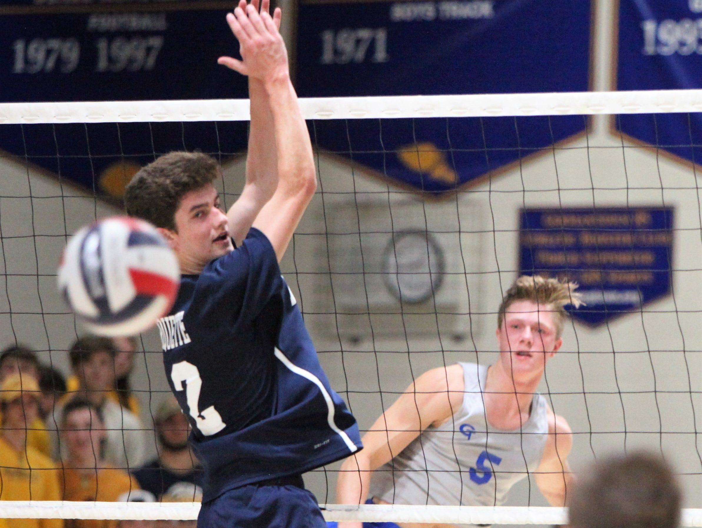 Germantown's Carter Schmidt and Marquette's Joe DeStefanis watch on as Schmidt's kill heads toward the ground during a match on Oct. 3.