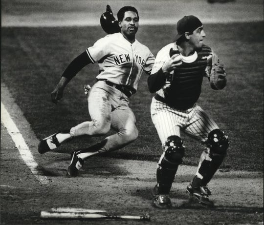 Dave Winfield of the New York Yankees prepared to slide under catcher Ted Simmons of the Milwaukee Brewers in an attempt to back up a double play in 1982.