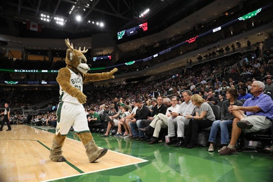 Bango greets the crowd during the Bucks' preseason opener against the Bulls on Wednesday night at Fiserv Forum, the team's new downtown arena.