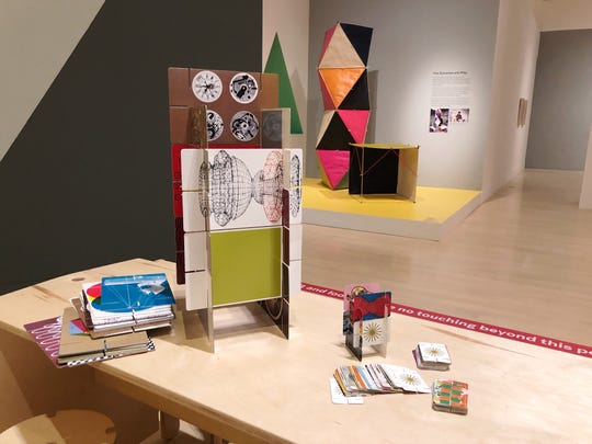 """Guests are invited to try their hand at building a house of cards in the """"Serious Play"""" exhibition at the Milwaukee Art Museum."""