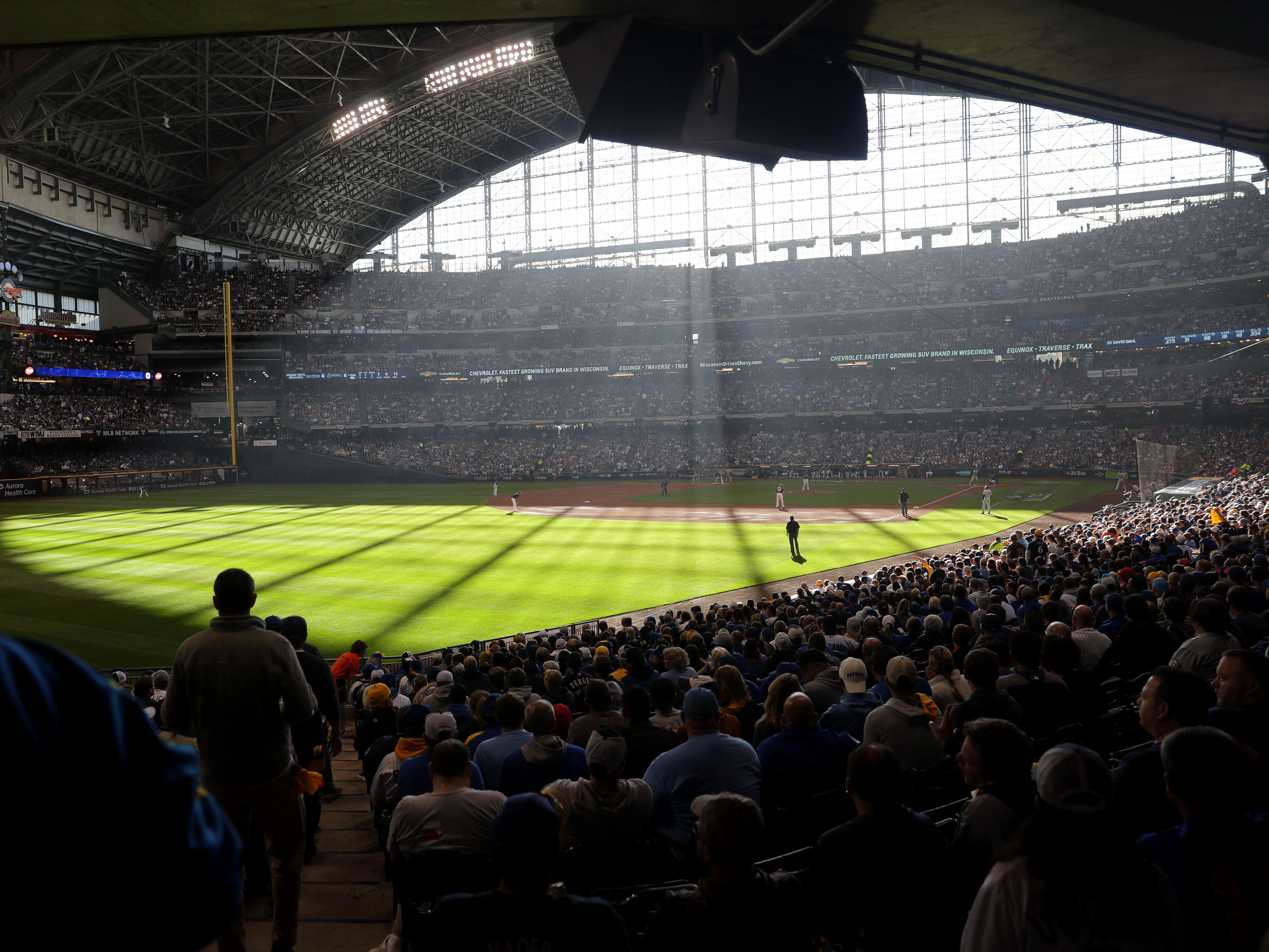 Sunlight shines on the field during the Milwaukee Brewers' National League Divisional Series game against the Colorado Rockies on Thursday at Miller Park.