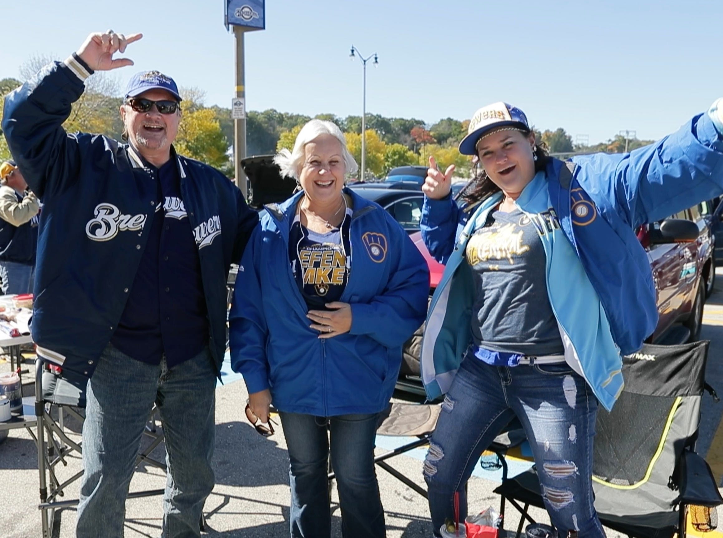 Tom Ullrich, his wife Luci and daughter Anna, all of Menomonee Falls, attend their first Brewer playoff game.