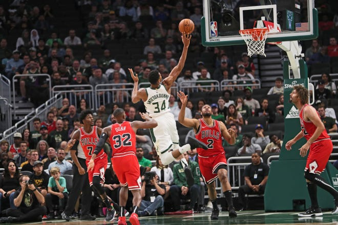 Giannis Antetokounmpo goes up for a shot in the middle of the Bulls defense during the Bucks' preseason opener and first game at Fiserv Forum on Wednesday night.