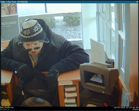 Security camera footage shows a man with a Halloween mask robbing PNC Bank in Glendale on Oct. 3.