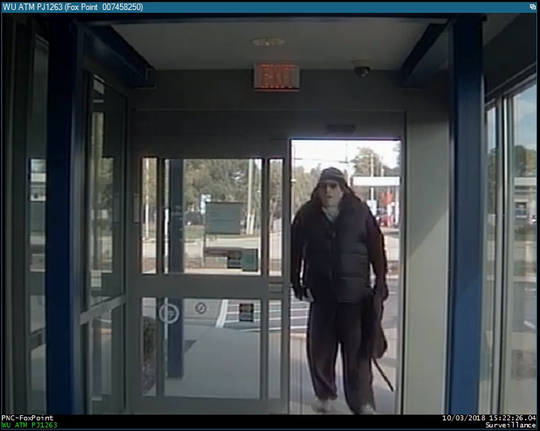 A man wearing a Halloween mask is captured on security camera shortly before robbing PNC Bank in Glendale on Oct. 3.