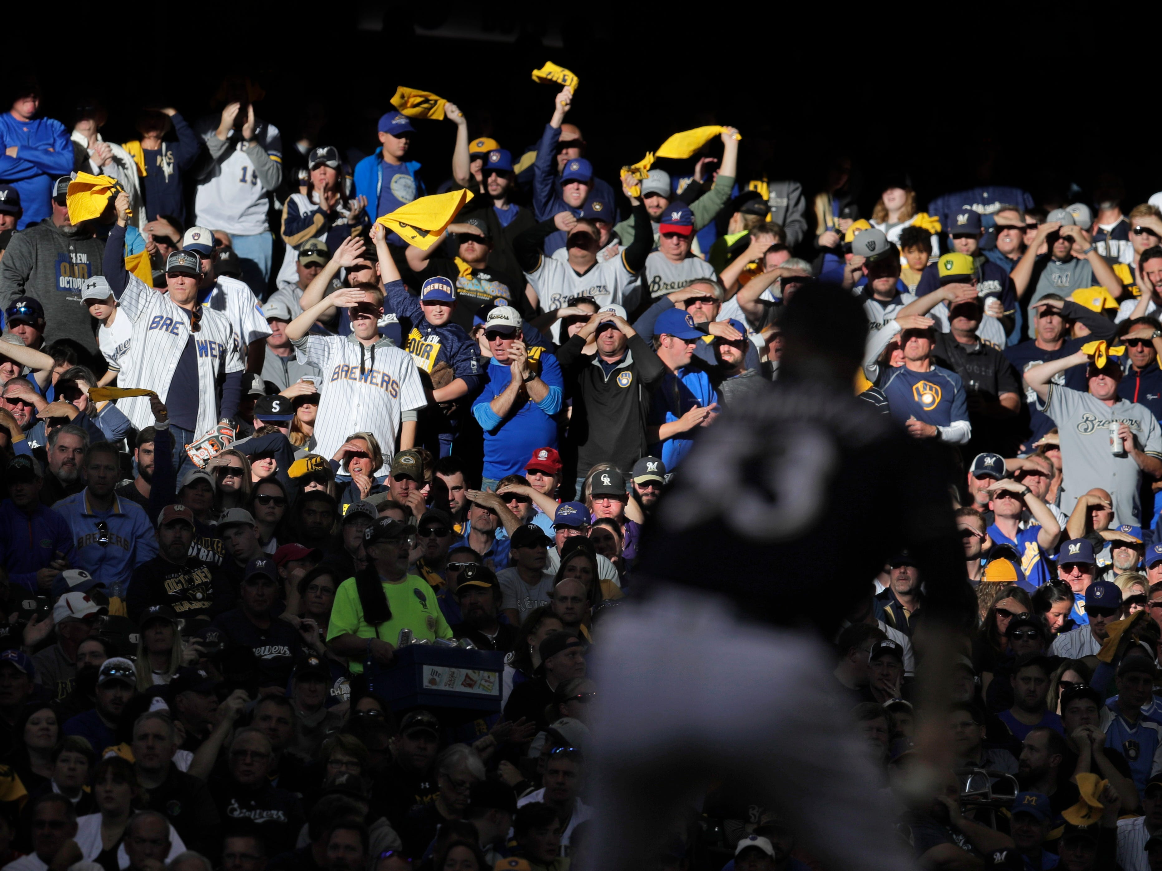 Milwaukee Brewers relief pitcher Brandon Woodruff (53) is cheered by fans in the third inning during Game 1 of the National league Division Series between the Milwaukee Brewers and Colorado Rockies at Miller Park in  Milwaukee on Thursday.