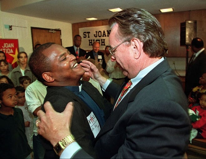 Robert Smith, then-president of Messmer High School, and then-Gov. Tommy Thompson, celebrate the Wisconsin Supreme Court decision allowing poor children in Milwaukee to attend religious schools at taxpayers' expense in June 1998.