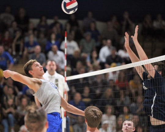 Germantown's Jackson Van Engen loads up for a kill against Marquette on Oct. 3.