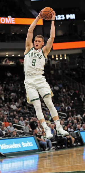 Bucks rookie Donte DiVincenzo pulls down one of his seven rebounds against the Bulls.