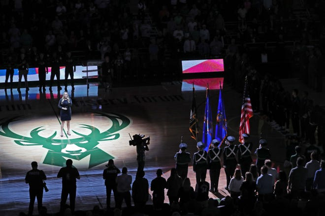 Jenny Thiel sings the National Anthem before the Bucks' preseason opener against the Bulls and the team's first game at the new Fiserv Forum.