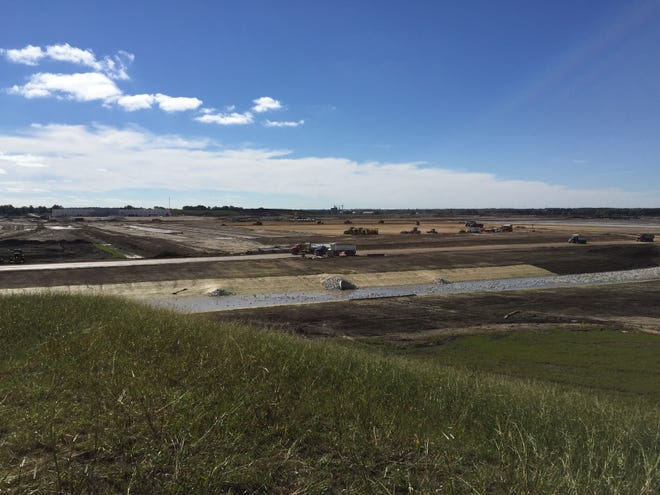 Seen from atop a 30-foot mound of topsoil scraped from the site, the Foxconn construction acres spreads over hundreds of acres in Mount Pleasant.