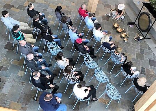 Promega employees at the company's Madison headquarters practice sound meditation.