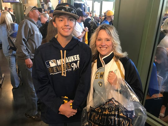 Nicki Schroder and her son, Cayden, of Rockford, hit the Milwaukee Brewers Team Store before Thursday's game against the Colorado Rockies.
