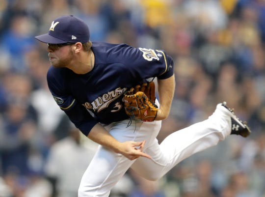 Brewers reliever Corbin Burnes fires in a pitch against the Rockies in the fourth inning of Game 1 of the teams' NL Division Series on Thursday afternoon at Miller Park.