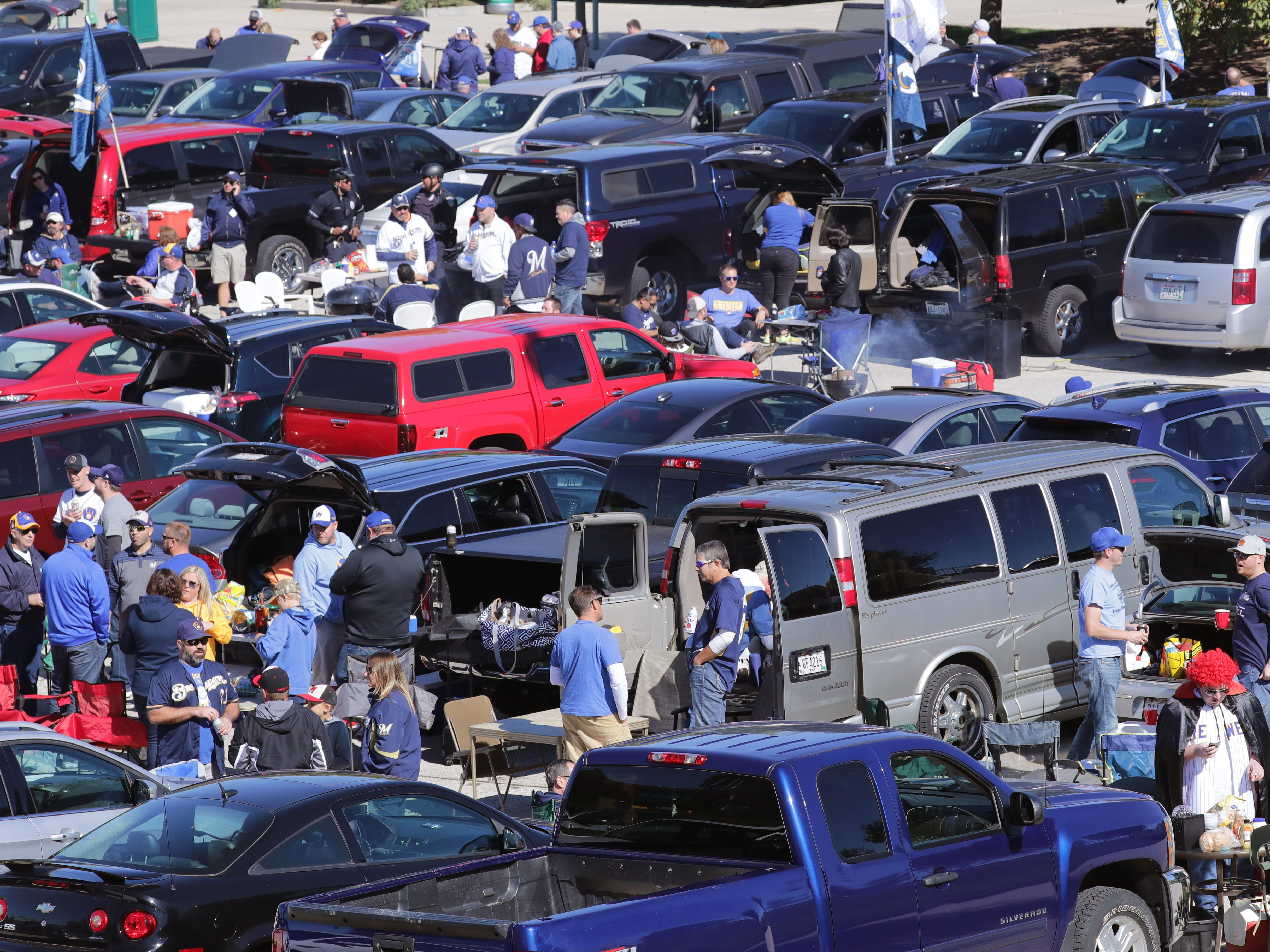Fans tailgate before the Milwaukee Brewers National League Divisional Series game against the Colorado Rockies.