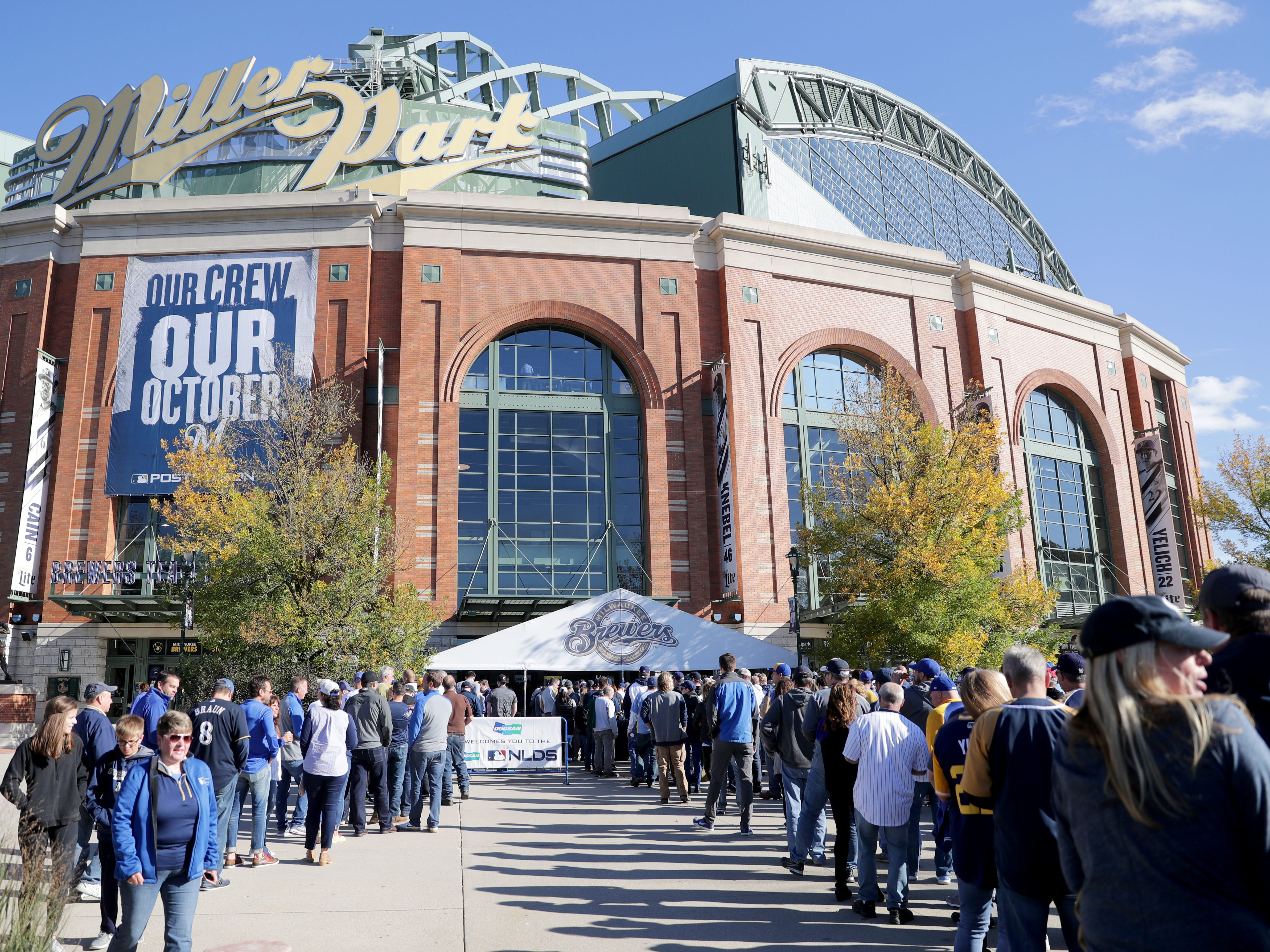 People line up to get into Miller Park  before the Milwaukee Brewers' National League Divisional Series game against the Colorado Rockies on Thursday.