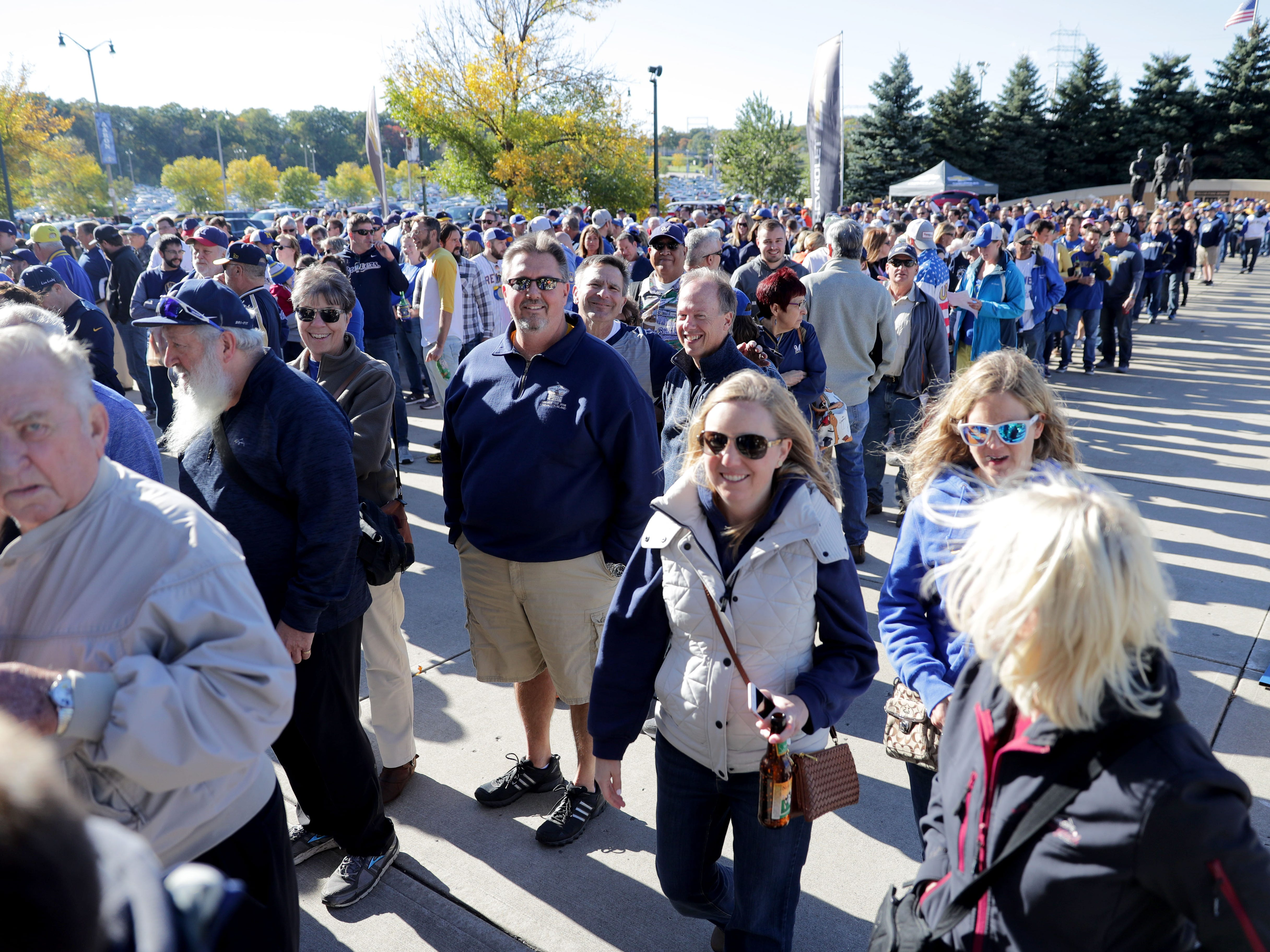 People line up to get into Miller Park before the Milwaukee Brewers' National League Divisional Series game against the Colorado Rockies.