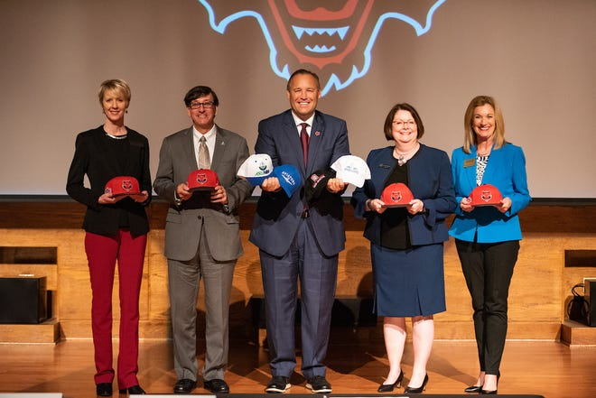 """Campus chancellors (from left) Debra West, ASU Mid-South, Robin Myers, ASU-Mountain Home, Kelly Damphousse, A-State, Jennifer Methvin, ASU-Beebe, and Sandra Massey, ASU-Newport celebrate the announcement of the """"Every Red Wolf Counts"""" initiative."""