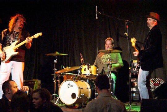 Zig & The Zigtones with Ziggy Luis, left on guitar, Joe Thomas Jr. on bass and Ben Hagler on drums.