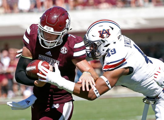 Mississippi State quarterback Nick Fitzgerald (7) is tackled by Auburn linebacker Darrell Williams (49) on Saturday, Oct. 8, 2016, in Starkville, Miss. Auburn won 38-14.