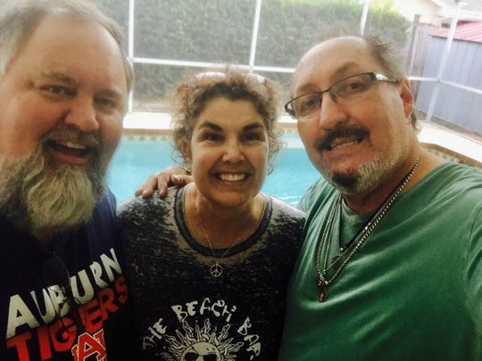 Ziggy Luis, right, with wife Lee Nabergall Luis and longtime friend Michael Winkelman.