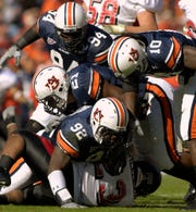 Arkansas State running back Cedric Wilkerson (23) is tackled by Auburn defenders Christopher Browder  (92), Karibi Dede  (21), Sen'Derrick Marks  (94) and Tray Blackmon  (10) on Saturday, November 4, 2006, in Auburn, Ala. Auburn won, 27-0.
