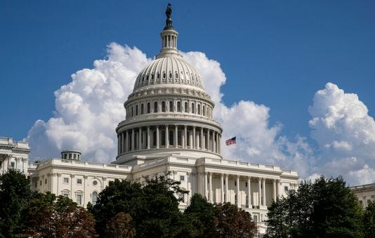 In this Monday, Sept. 3, 2018 file photo, an American flag flies on the U.S. Capitol in Washington.